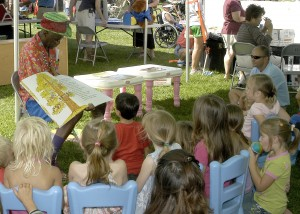 070421-N-1280S-001 PEARL HARBOR, Hawaii (April 21, 2007) - Wally Amos, founder of Famous Amos Cookies takes children on a reading adventure during Springfest, an event that celebrates children during the Month of the Military Child on Naval Station Pearl Harbor. Springfest was celebrated in conjunction with Earth Day events worldwide. U.S. Navy photo by Mass Communication Specialist 2nd Class Lindsay Switzer (RELEASED)