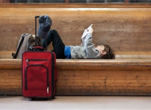 Boy reads book while traveling