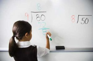 Girl Practicing Long Division --- Image by © Corbis