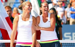 NEW YORK, NY - SEPTEMBER 09: Sara Errani and Roberta Vinci of Italy laugh before receiving the trophy following their victory against Andrea Hlavackova and Lucie Hradecka of the Czech Republic in their women's doubles final match on Day Fourteen of the 2012 US Open at USTA Billie Jean King National Tennis Center on September 9, 2012 in the Flushing neighborhood of the Queens borough of New York City. (Photo by Cameron Spencer/Getty Images)