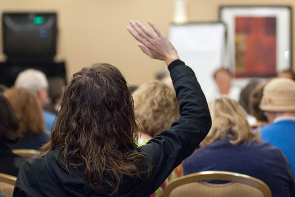 research_hand-raised-at-conference